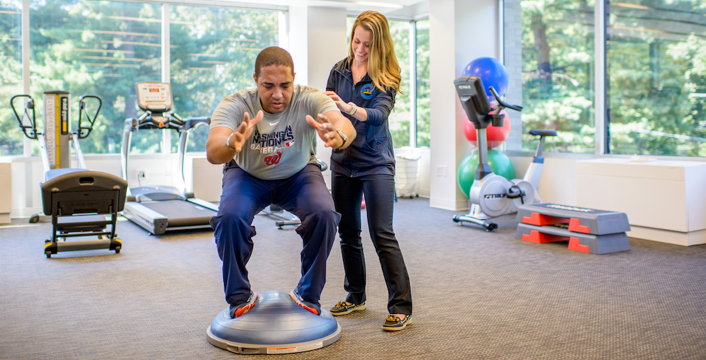 Point Performance's Joanna Bakos, DPT applies physical therapy to injured patient