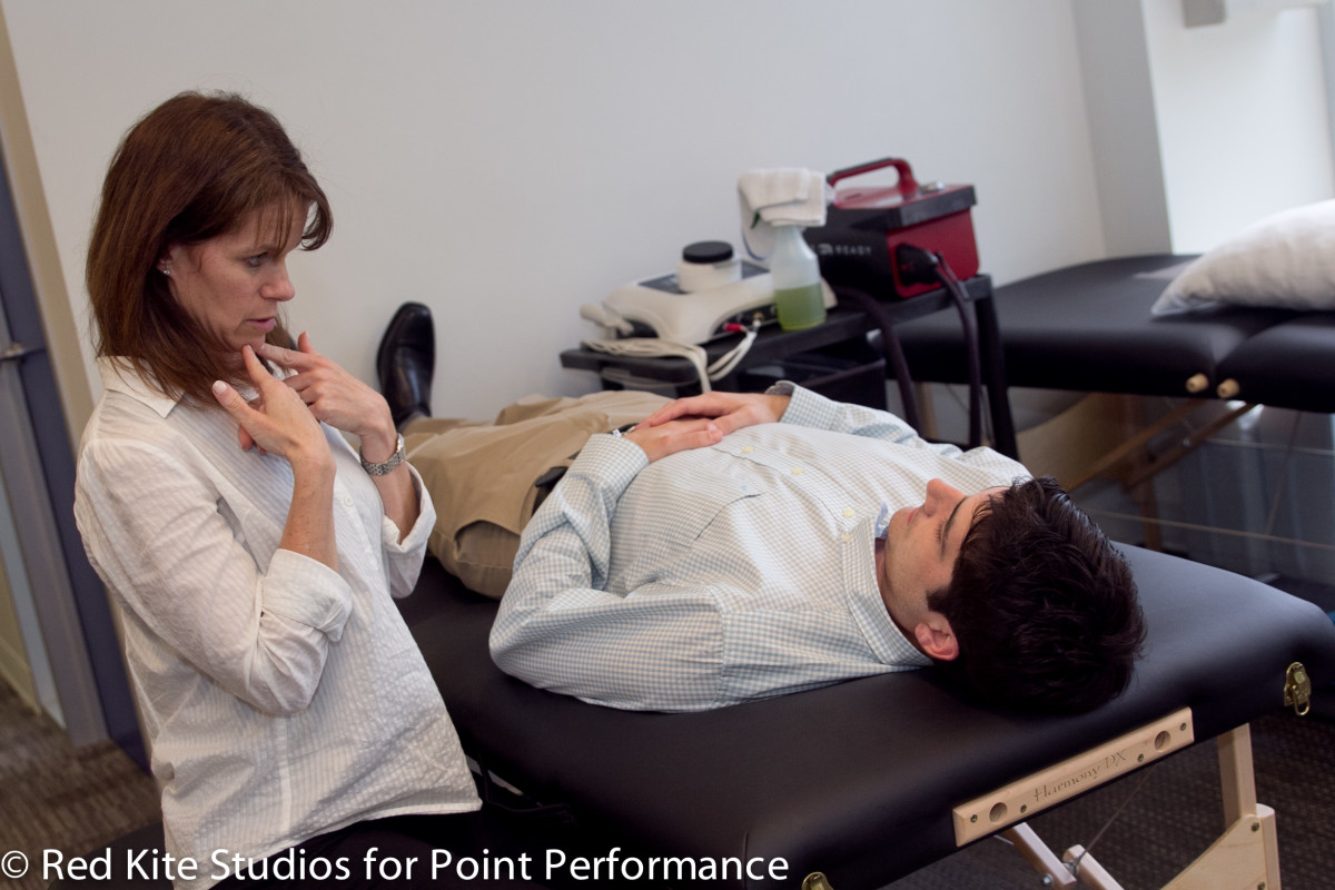 Point Performance's Julie Shein works with concussion patient to restore balance