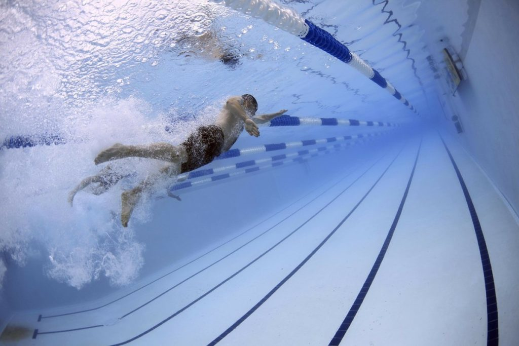 man swimming laps in lane