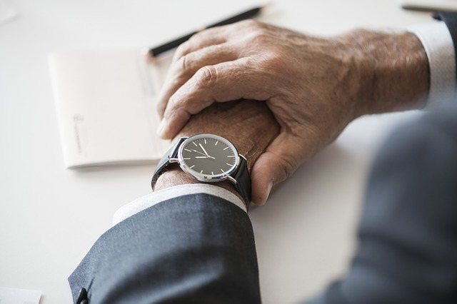 person checking wristwatch