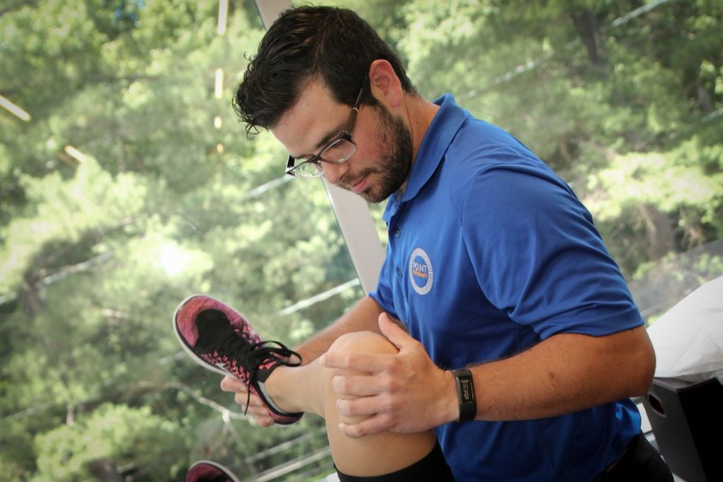 Point Performance physical therapist Adam Gershowitz works on a patient's knee osteoarthritis